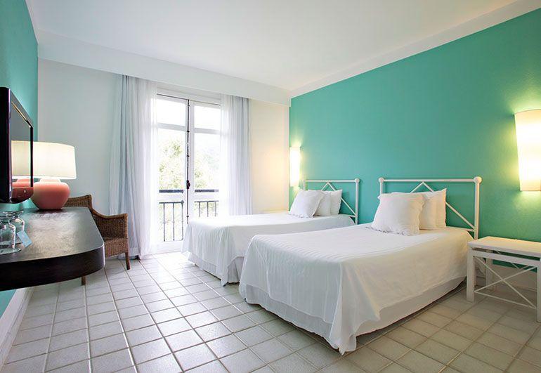Apartamento com duas camas de solteiro