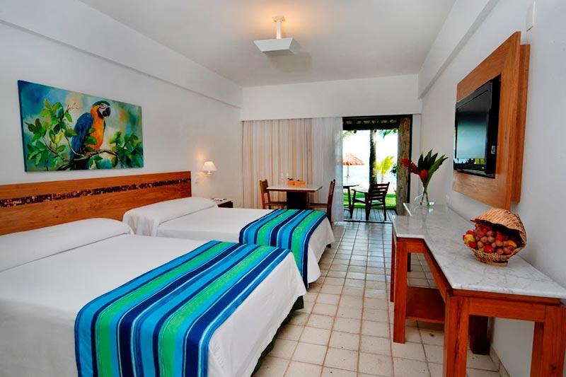 Beach Room detalhes camas casal com vista mar